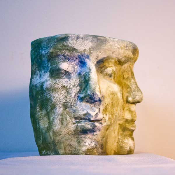 Two faces, polychrome terracotta