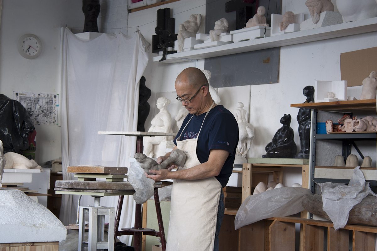 vancouver sculptor at work in studio on clay sculpture