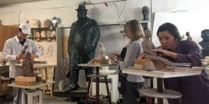 students at work on sculpture