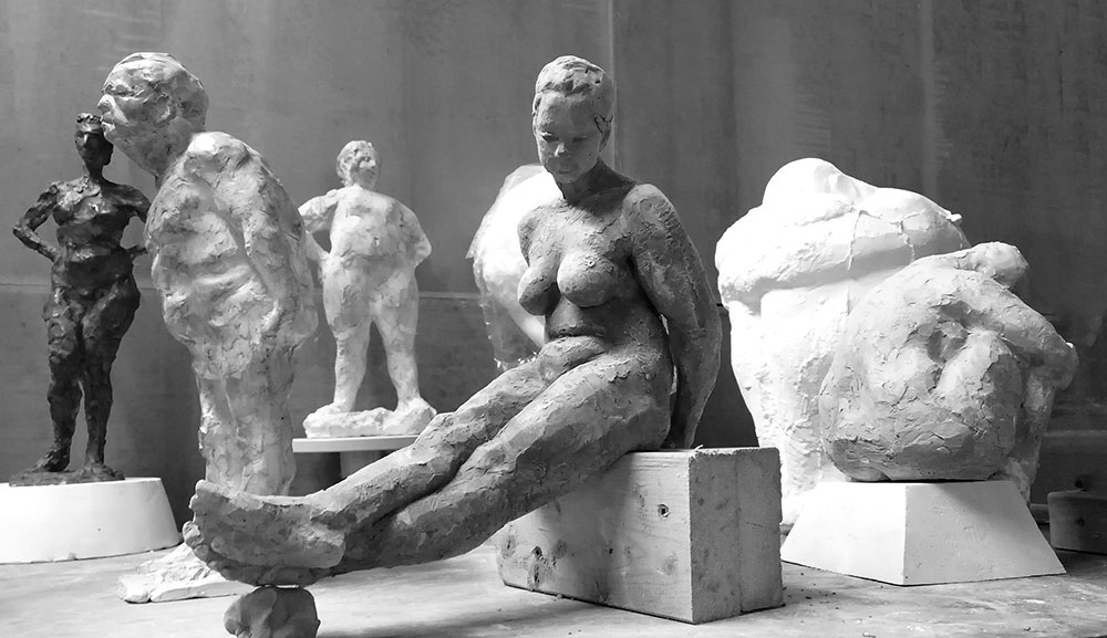 figurative sculpture of seated and standing models